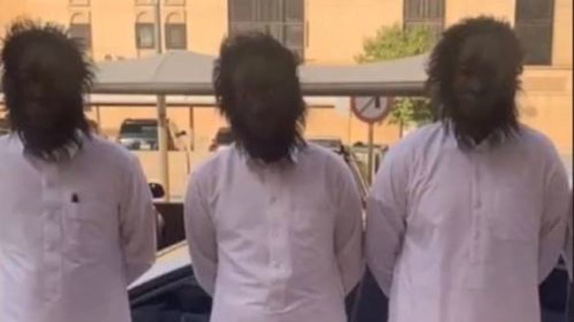Three of the four men who were arrested for wearing scary masks and chasing people in Riyadh. (Twitter)