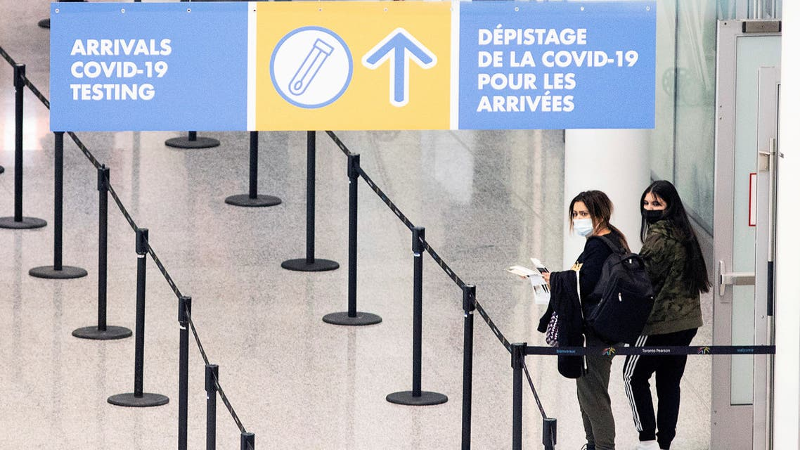 Passengers arrive at Toronto's Pearson airport after mandatory coronavirus disease (COVID-19) testing took effect for international arrivals in Mississauga, Ontario, Canada February 1, 2021. (Reuters)