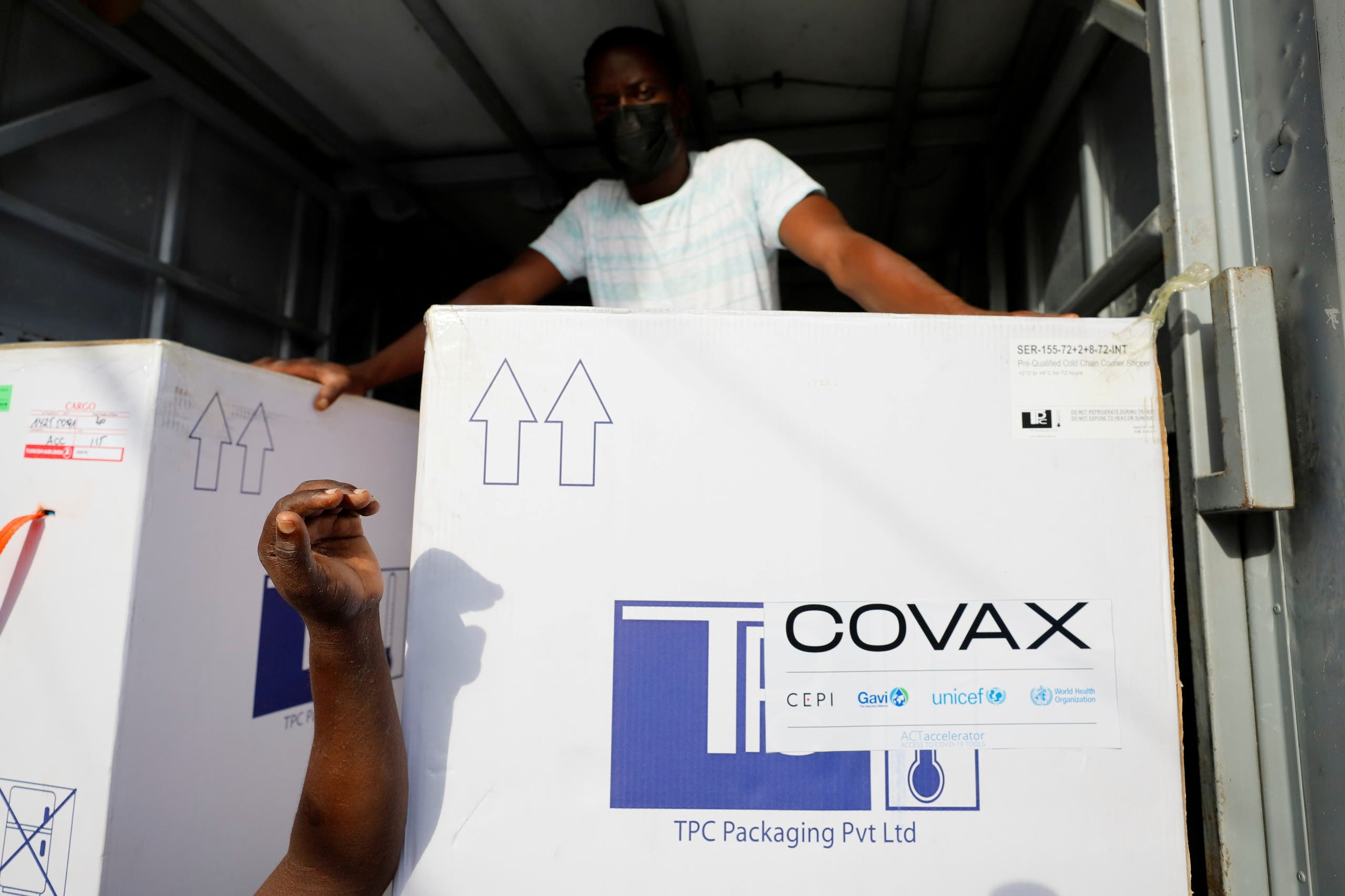 Boxes of Oxford/AstraZeneca coronavirus disease (COVID-19) vaccines, redeployed from the Democratic Republic of Congo, arrive at a cold storage facility in Accra, Ghana, May 7, 2021. (File Photo: Reuters)