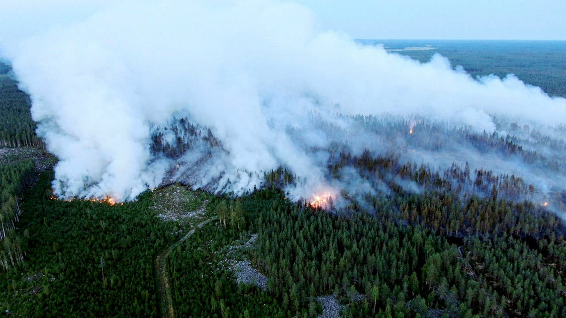 An aerial view shows a forest fire raging in Kalajoki, Northern Ostrobothnia region, north-western Finland, on July 26, 2021. (AFP)
