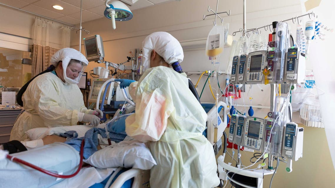 Healthcare personnel work in a coronavirus disease (COVID-19) intensive care unit where they are dealing with a surge in cases of the Delta variant at Intermountain Medical Center in Murray, Utah, U.S., in this handout photo provided July 23, 2021. Courtesy of Intermountain Health/Handout via REUTERS THIS IMAGE HAS BEEN SUPPLIED BY A THIRD PARTY. NO RESALES. NO ARCHIVES. MANDATORY CREDIT