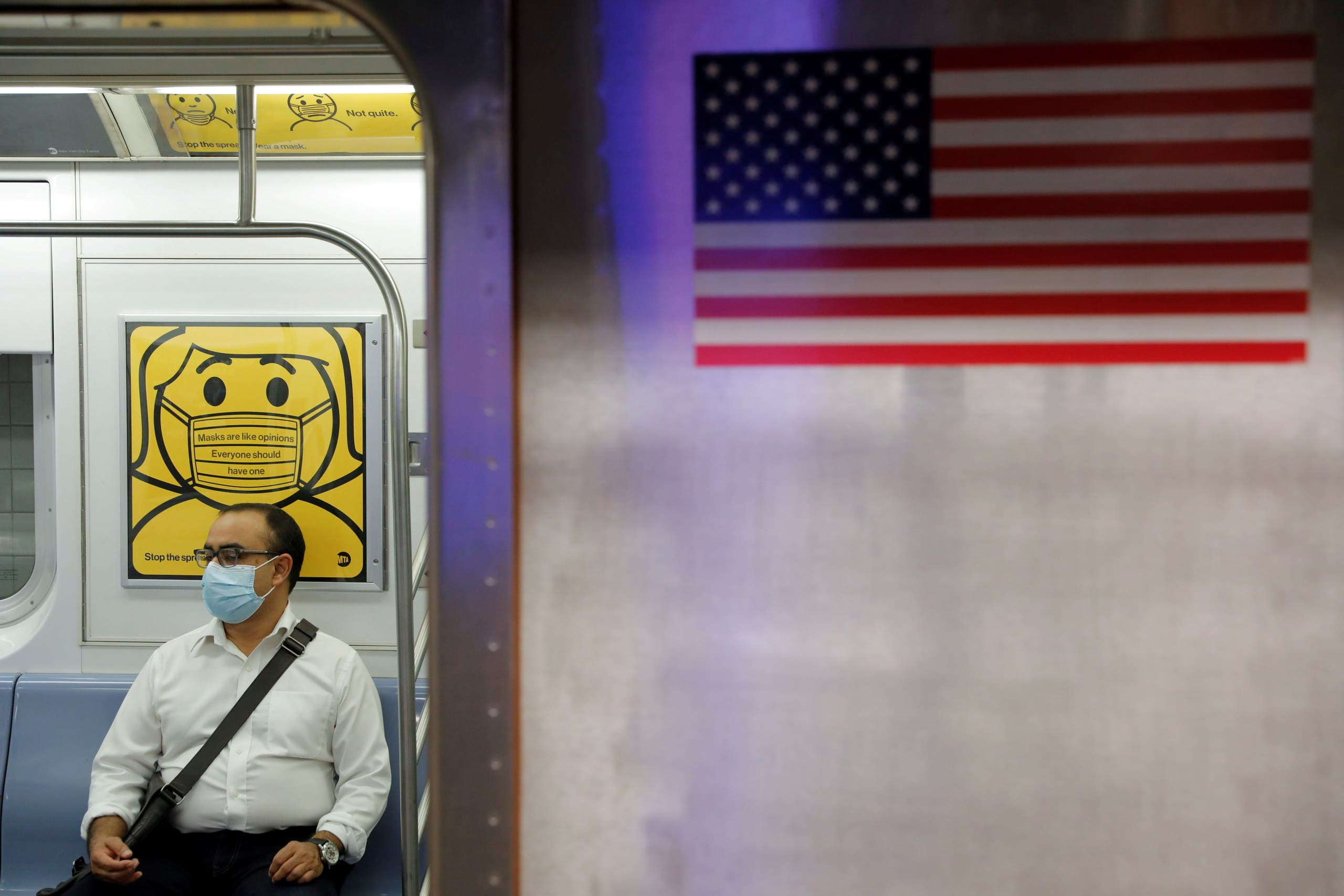 A commuter wears a mask while riding the subway as cases of the infectious coronavirus Delta variant continue to rise in New York City, New York, US, July 26, 2021. (File photo: Reuters)