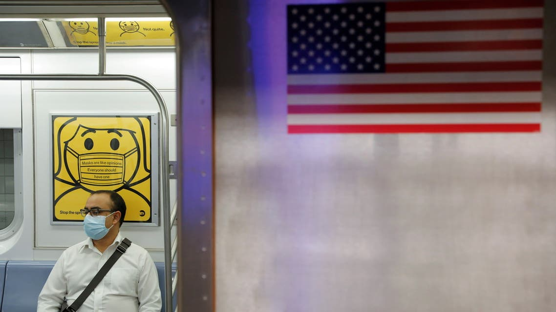 FILE PHOTO: A commuter wears a mask while riding the subway as cases of the infectious coronavirus Delta variant continue to rise in New York City, New York, U.S., July 26, 2021. REUTERS/Andrew Kelly/File Photo