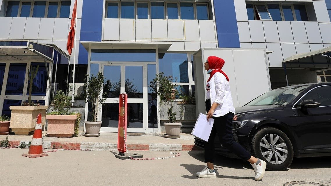 A woman walks past the building of the moderate Islamist Ennahda party headquarters in Tunis, Tunisia, July 29, 2021. (Reuters)