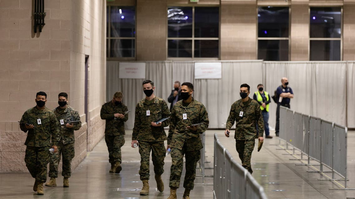 Military personnel walk through at one of FEMA's Community Vaccination Center in Philadelphia, Pennsylvania, U.S., March 2, 2021. (Reuters)