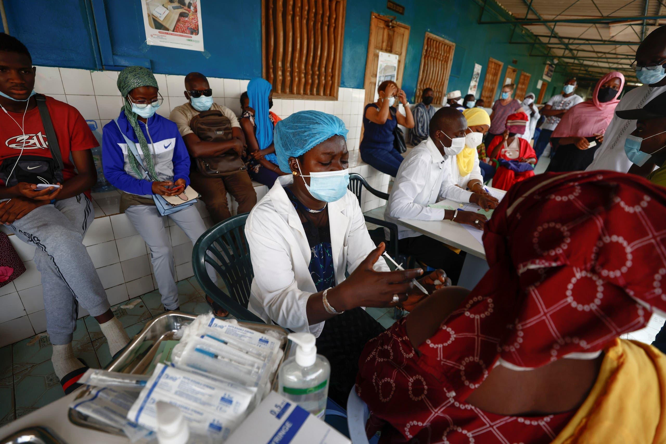 Aminata Laye Diagne, a nurse gives a dose of coronavirus disease (COVID-19) vaccine to a woman at Philippe Senghor Hospital in Dakar, amid a surge of coronavirus disease (COVID-19) cases in Senegal July 28, 2021. Picture taken July 28, 2021. (Reuters)