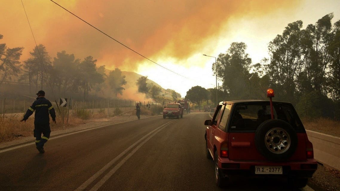 Firefighters work on a fire, in Labiri, near Patras, Greece's third largest city. (STR/Eurokinissi/AFP)