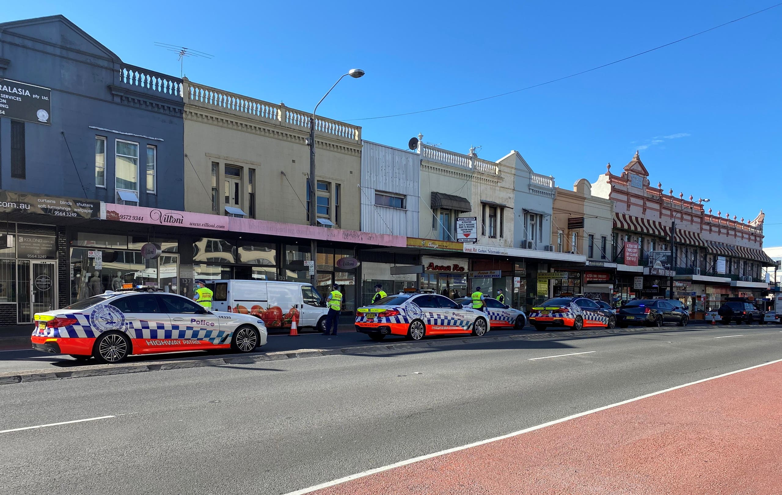 Police check the cars heading into the city while conducting a law enforcement operation to prevent anti-lockdown protesters from gathering during a lockdown to curb the spread of coronavirus disease (COVID-19) outbreak, in the Annandale suburb of Sydney, Australia, July 31, 2021. (Reuters)