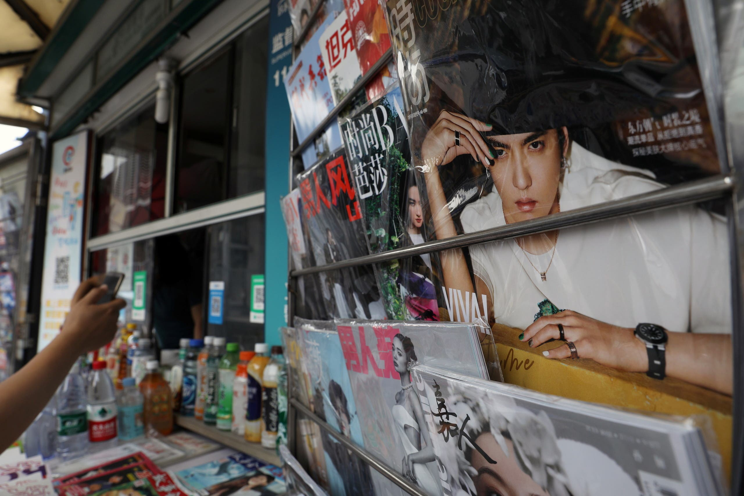 Singer-actor Kris Wu is seen on the cover of a fashion magazine at a newsstand in Beijing, China July 20, 2021. (Reuters)