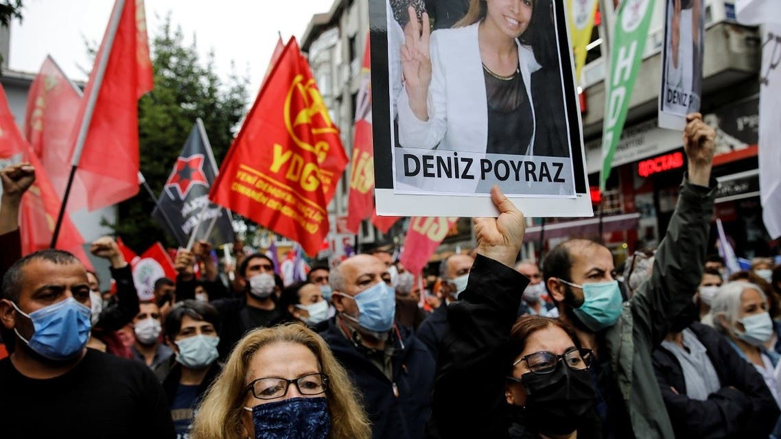Demonstrators carry a picture of Deniz Poyraz, who was killed in an attack on a local office of the pro-Kurdish Peoples' Democratic Party (HDP), during a protest in Istanbul, Turkey, on June 18, 2021. (Reuters)