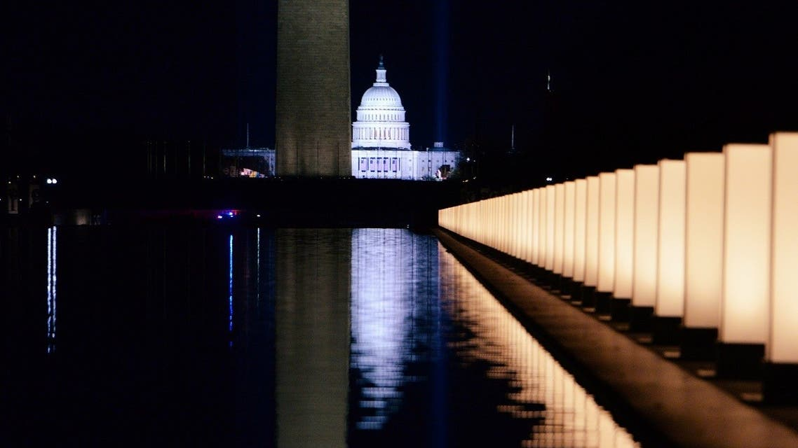 The Capitol Building is seen reflected after then-President-elect Joe Biden hosted a memorial to honor those who died from coronavirus disease, Jan. 19, 2021. (Reuters)