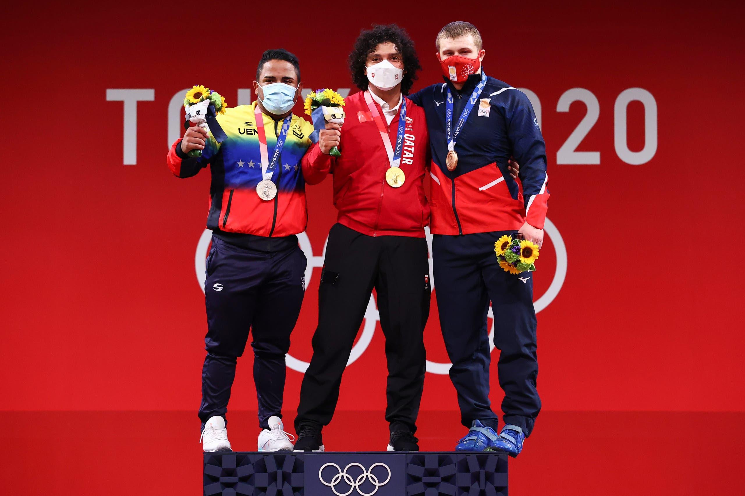 Gold medalist Fares Ibrahim Elbakh of Qatar, silver medalist Keydomar Vallenilla of Venezuela and bronze medalist Anton Pliesnoi of Georgia pose. (Reuters)