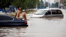 Death toll from China floods jumps to 302 with 50 people missing