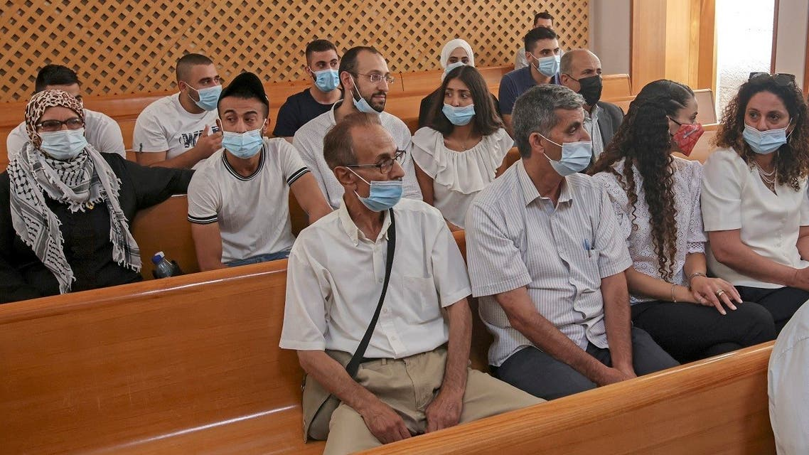 Palestinian residents of the Sheikh Jarrah neighborhood attend a hearing at Israel's supreme court in Jerusalem on August 2, 2021. (Ahmad Gharabli/AFP)