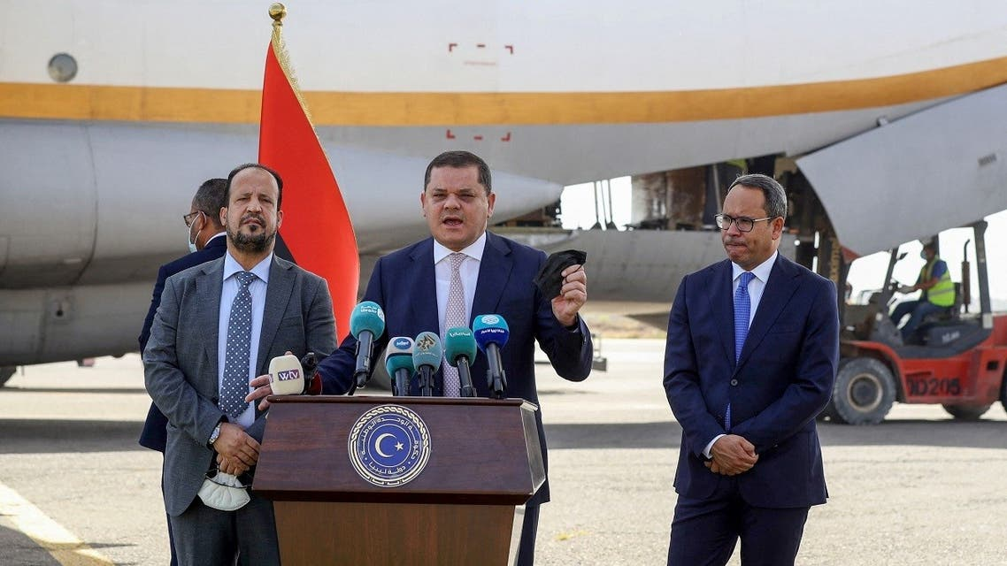 Libyan PM Abdulhamid Dbeibah (C) during a press conference after the arrival of over a million doses of the Chinese Sinopharm vaccine against COVID-19, at Mitiga International Airport in the capital Tripoli, on August 2, 2021. (Mahmud Turkia/AFP)
