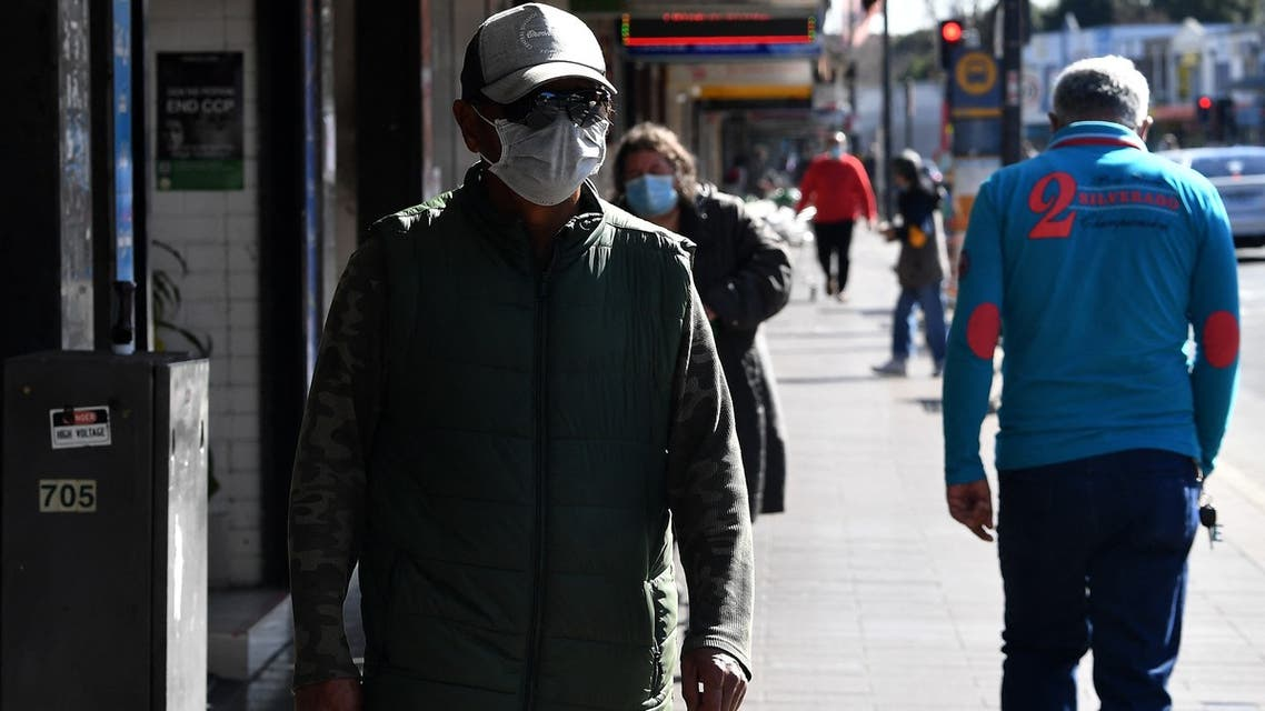 Residents walk through a street in the Fairfield suburb in Sydney on August 2, 2021, during the city's prolonged Covid-19 coronavirus lockdown. (File photo: AFP)