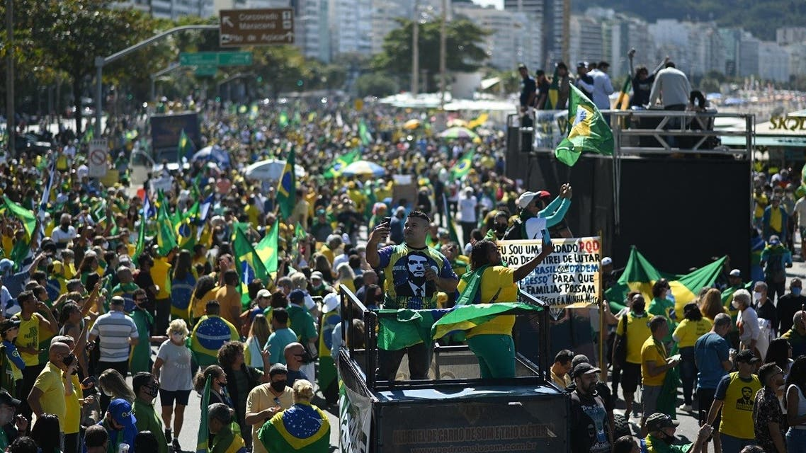 Supporters of Brazilian President Jair Bolsonaro take part in a demonstration calling for the addition of paper voting receipts to electronic ballots in the presidential election, at Copacabana Beach in Rio de Janeiro, Brazil on August 1, 2021. (Andre Borges/AFP)
