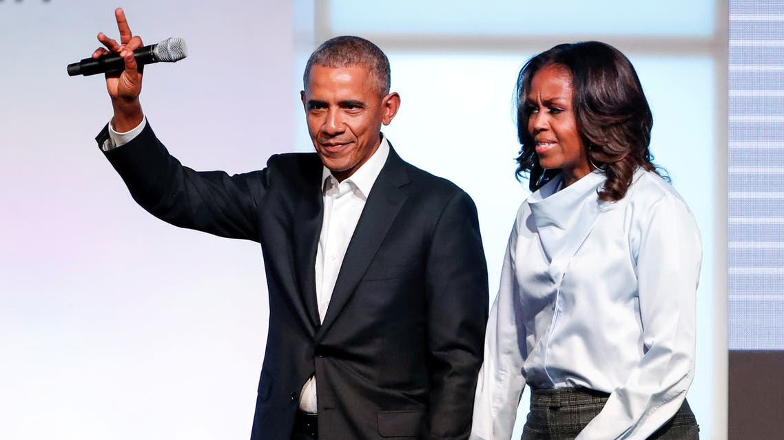 أوباما وزوجته (رويترز- أرشيفية)