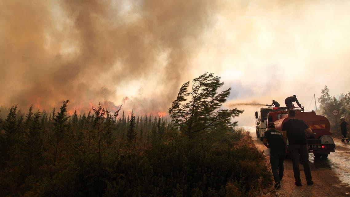 Firefighters extinguish a wildfire in the Mazi region near Bodrum, Turkey, August 2, 2021. (Reuters)