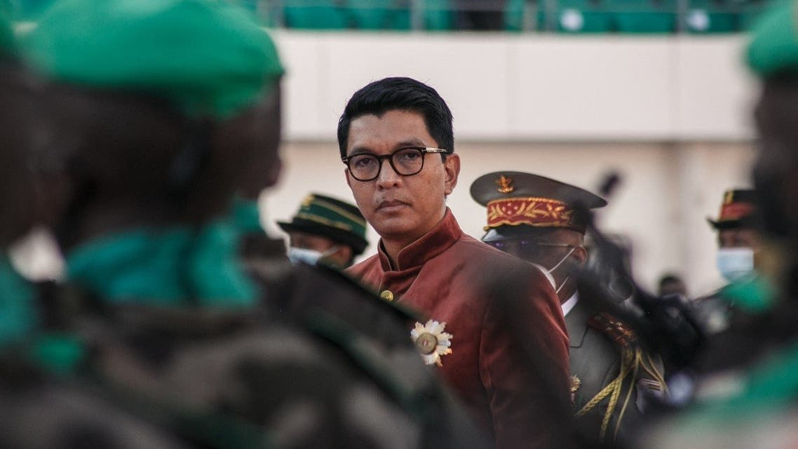 In this file photograph taken on June 26, 2021, Madagascar's President Andry Rajoelina inspects troops during Independence Day celebrations at The Barea Stadium in Antananarivo. (Rijasolo/AFP)