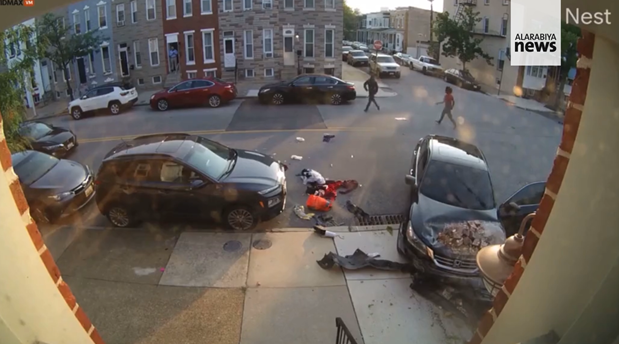 The moment a woman tried to run over a man during a heated argument in Baltimore, US. (Screengrab)