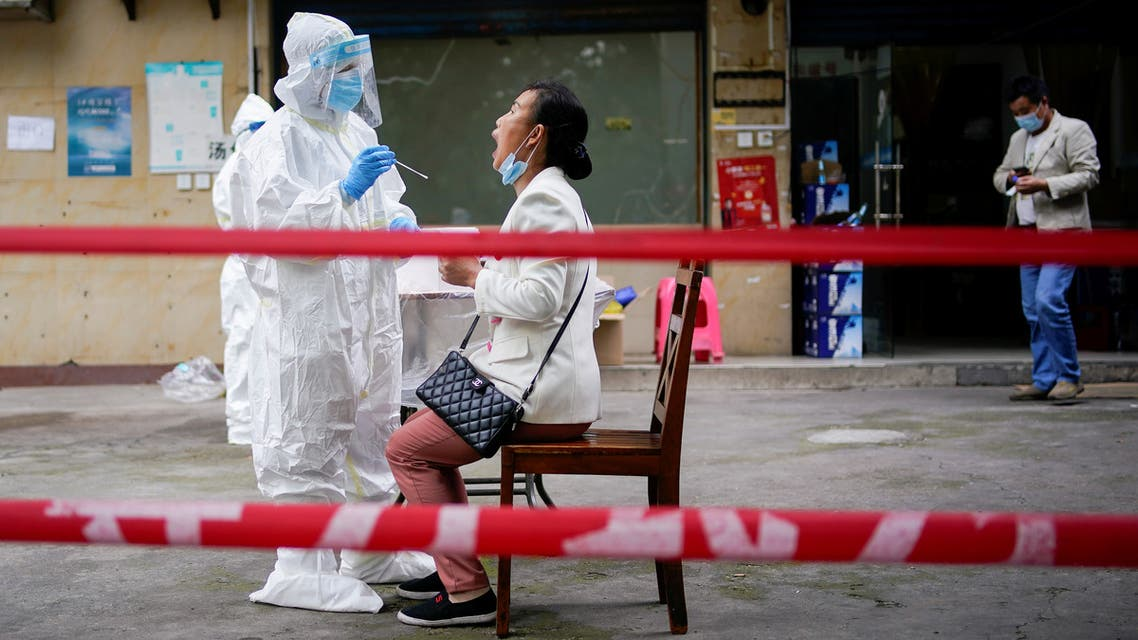 A medical worker in protective suit conducts nucleic acid testings for residents at a residential compound in Wuhan, the Chinese city hit hardest by the coronavirus disease (COVID-19) outbreak, Hubei province, China May 15, 2020. (Reuters)