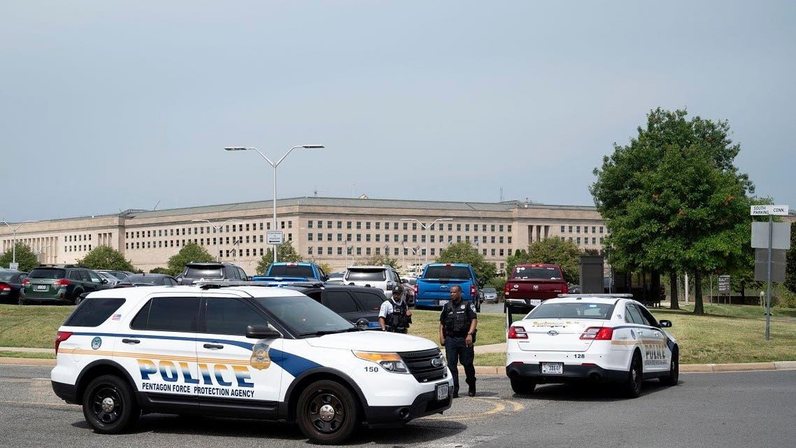 Police block off an entrance to the Pentagon following reports of multiple gun shots fired on a bus platform near the facility's Metro station, Aug. 3 2021. (AP)