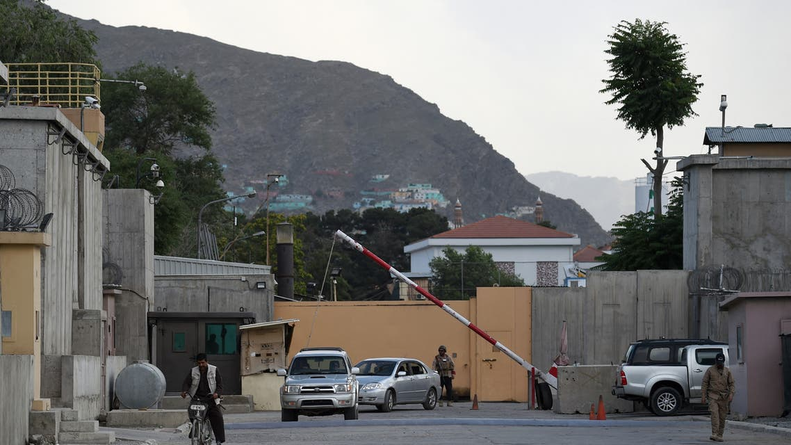 In this photo taken on June 19, 2019, Afghan security personnel check vehicles at a gate in the Green Zone in Kabul. A labyrinth of concrete blast walls, spotlights, and checkpoints are eating up ever more of Kabul, standing in stark contrast to a similar area in Iraq's Baghdad where easing tensions have seen its barricades come down.