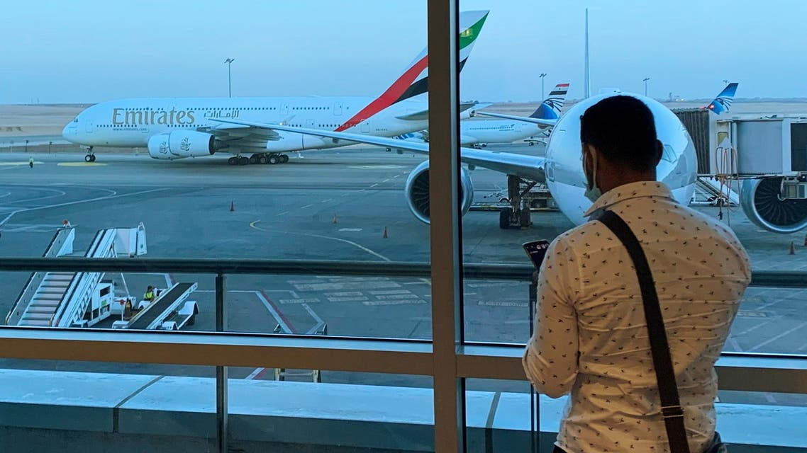 A passenger waits for his Emirates Airlines' flight departure to Dubai at Cairo's International Airport, Egypt July 20, 2021. (Reuters)