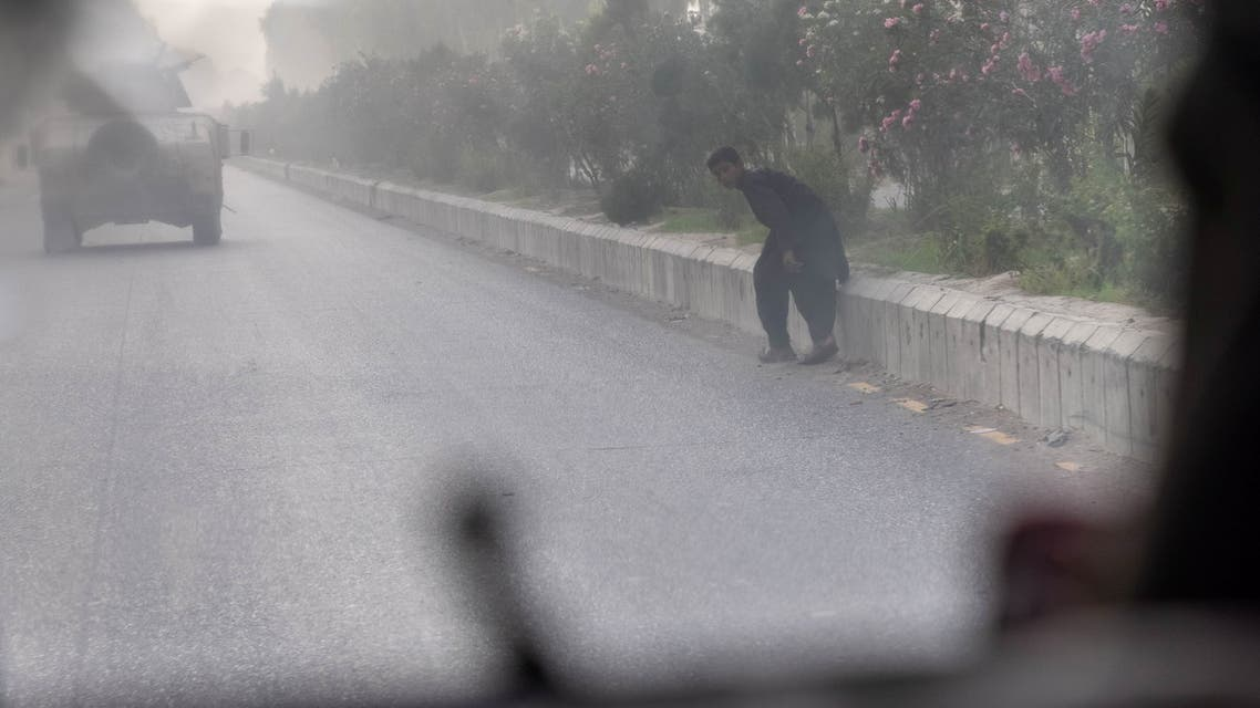 A civilian runs for cover as Afghan Special Forces and Taliban clash during the rescue mission of a police officer besieged at a check post, in Kandahar province, Afghanistan, July 13, 2021. (File photo: Reuters)