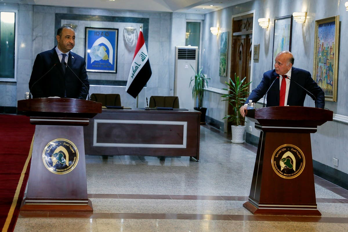 Iraqi Foreign Minister Fouad Hussein speaks with Iraqi Culture Minister Hassan Nadhim during a news conference at the Ministry of Foreign Affairs in Baghdad, Iraq August 3, 2021. (Reuters/Saba Kareem)
