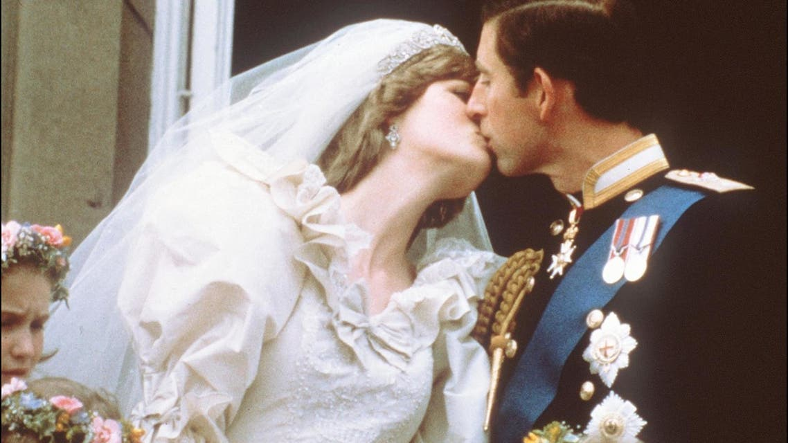 In this file photo taken on July 29, 1981 Charles, Prince of Wales, kisses his bride, Lady Diana, on the balcony of Buckingham Palace when they appeared before a huge crowd, after their wedding in St Paul's Cathedral. London, July 29, 1981. File photo: AFP)