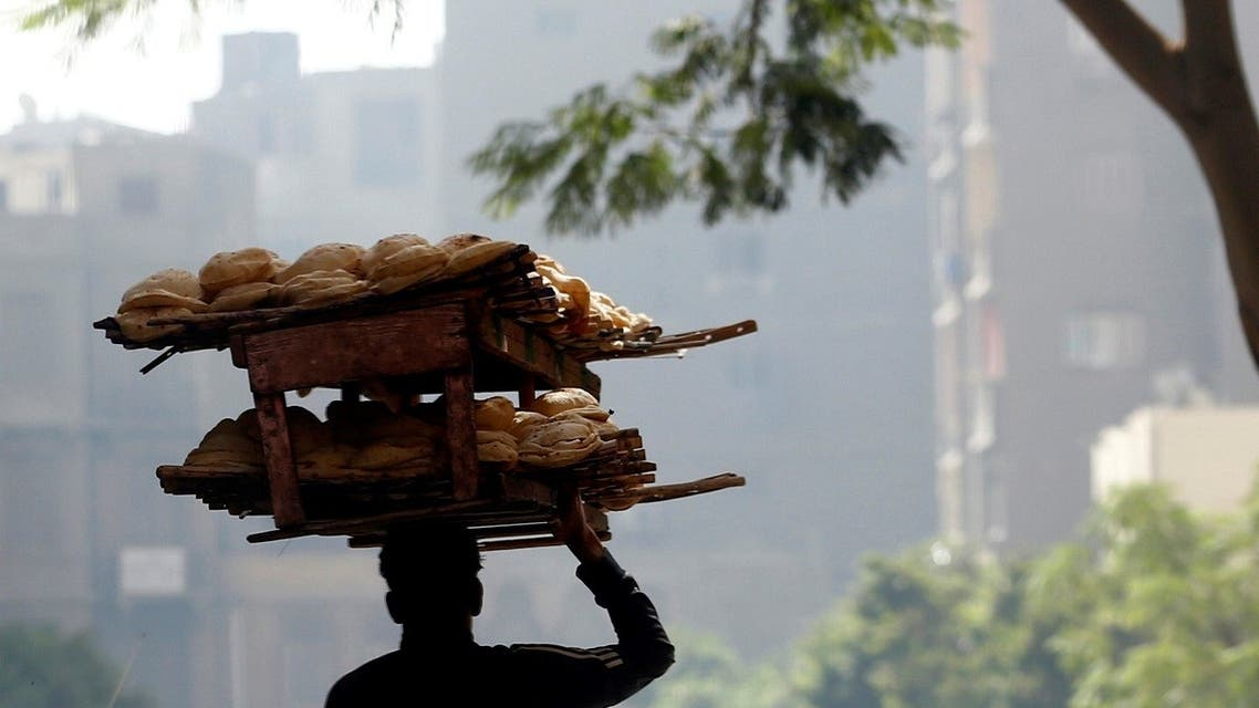 A bakery worker carries fresh bread in Cairo, Egypt. (File photo: Reuters)