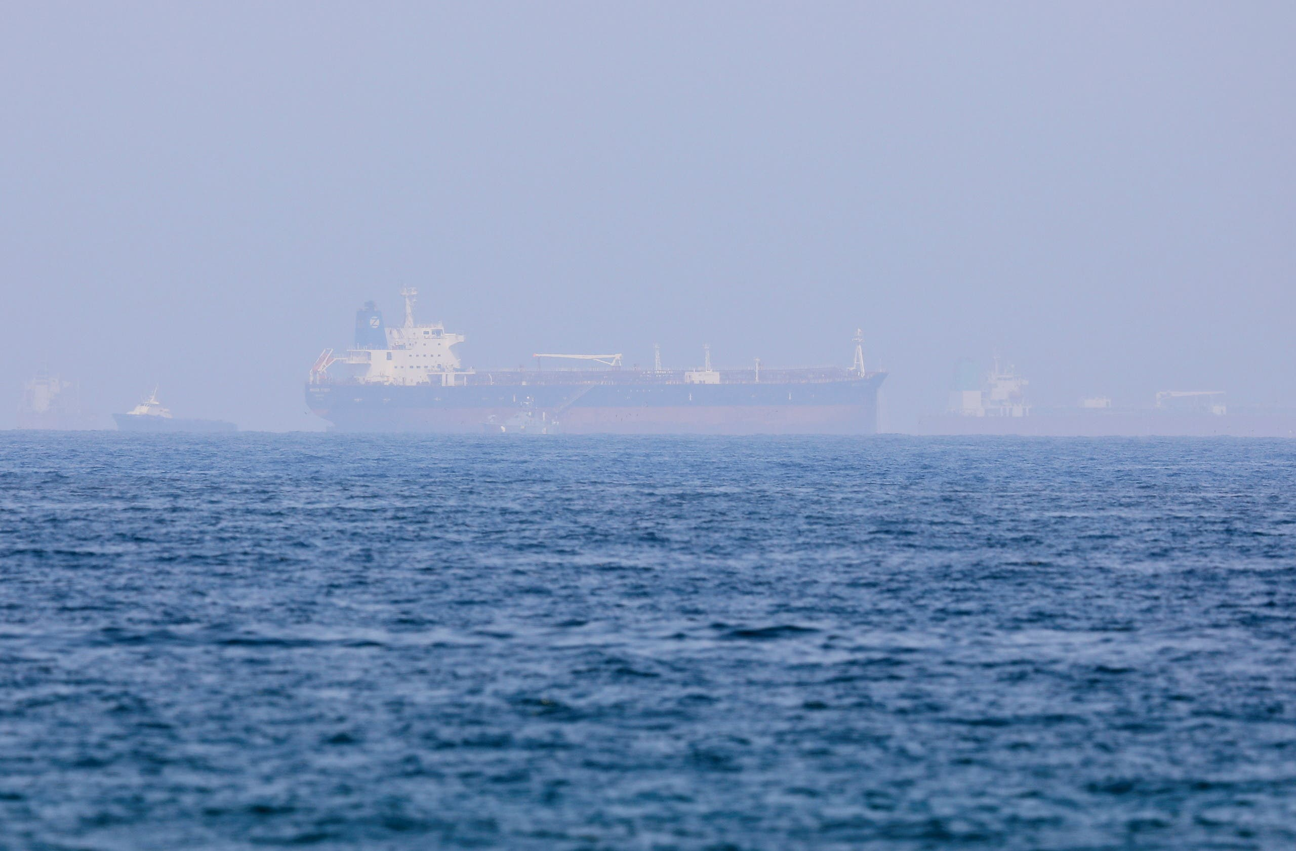 Ships including the Mercer Street, an Israeli-managed oil tanker are seen off Fujairah Port in United Arab Emirates, August 3, 2021. (Reuters)