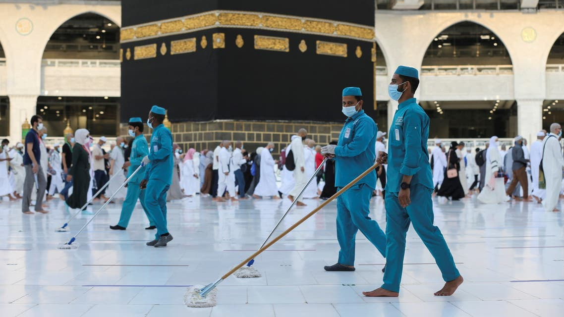 Workers walk cleaning the floor as pilgrims perform final Tawaf during the annual Haj pilgrimage, in the holy city of Mecca, Saudi Arabia July 20, 2021. (Reuters)