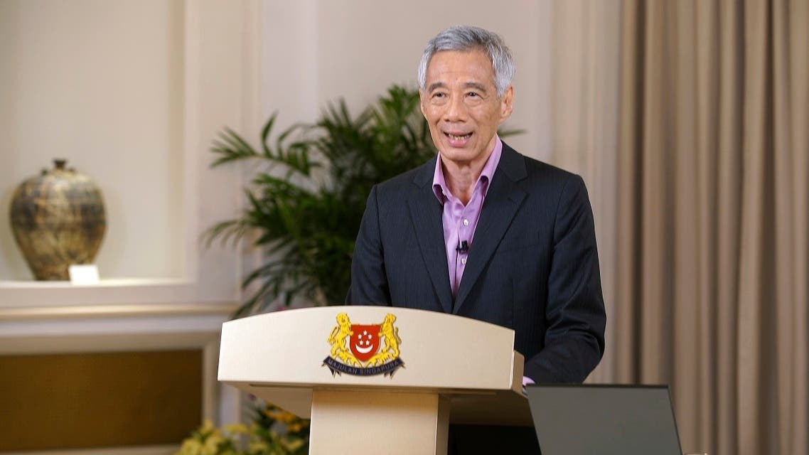 Prime Minister Lee Hsien Loong addresses the nation with updates on the COVID-19 situation in the city state Monday, May 31, 2021, in Singapore. (Ministry of Communications and Information via AP)