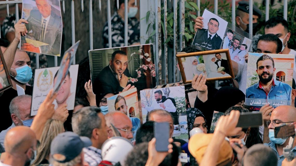 Relatives of victims of the August 4 blast carry pictures during a protest demanding accountability as the anniversary approaches of Lebanon's worst peace-time disaster, near the Justice Palace in Beirut on July 14, 2021.