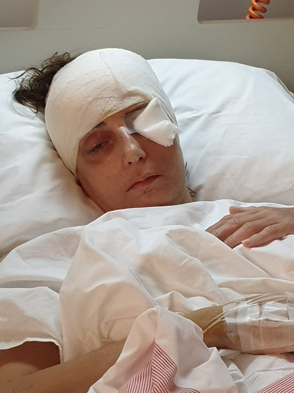 Rita Freiha Khoury, recovering in a hospital bed right after being heavily injured during the blast. (Supplied)