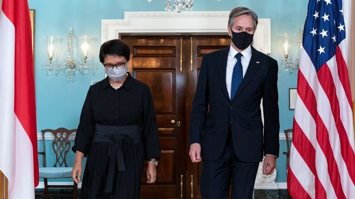 Blinken and Indonesian FM Retno Marsudi walk to meet members of the media after a bilateral meeting at Department of State in Washington, US, August 3, 2021. (Jose Luis Magana/Pool via Reuters)