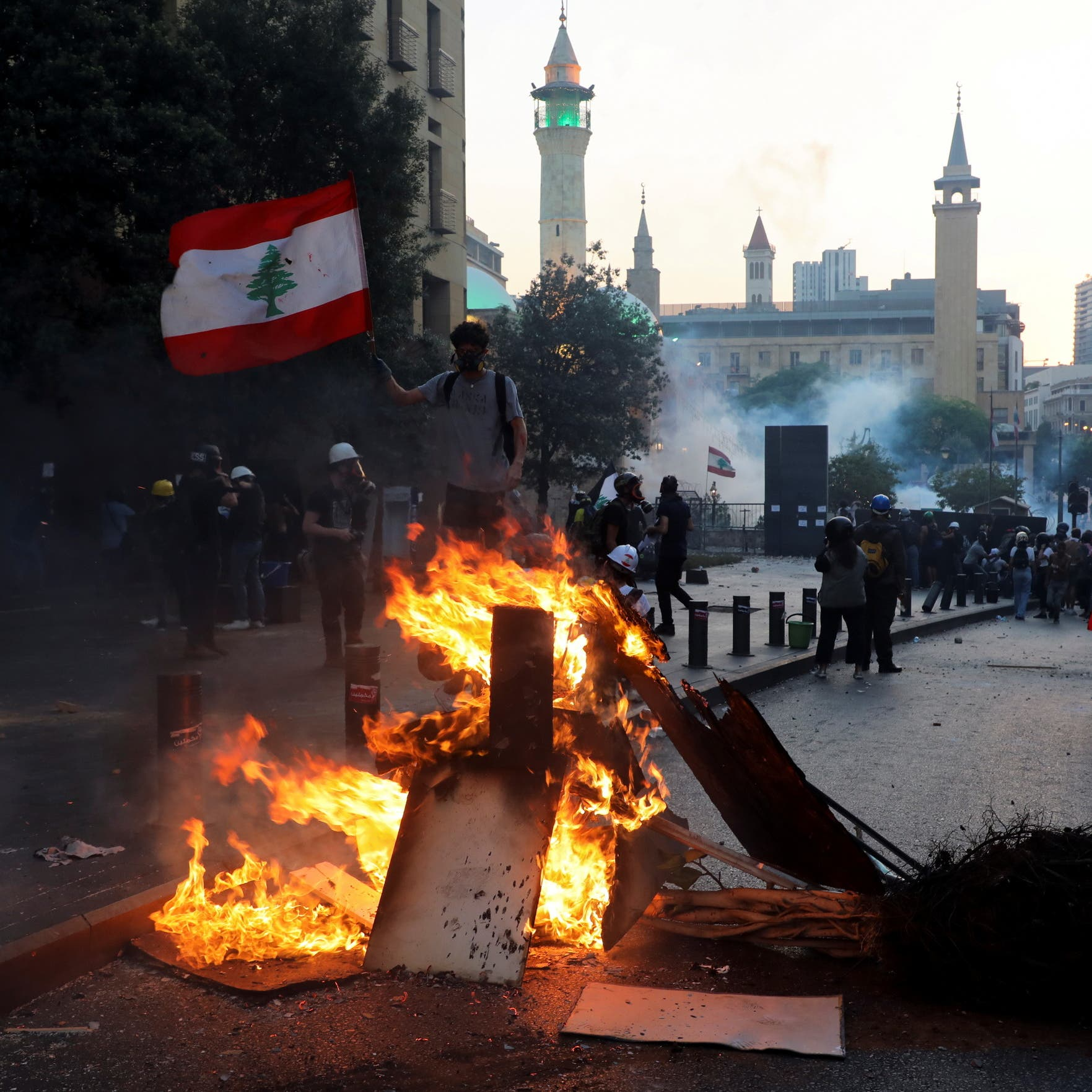 'Iran out:' Anti-Hezbollah protesters march in Lebanon on Beirut blast anniversary