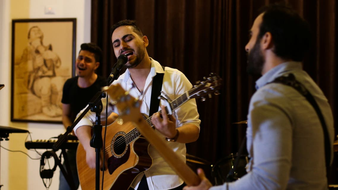 Palestinian accountant, Raji El-Jaru, sings and plays the guitar during a rehearsal for the first rock music band Osprey V in Gaza City August 1, 2021. Picture taken August 1, 2021. (Reuters)
