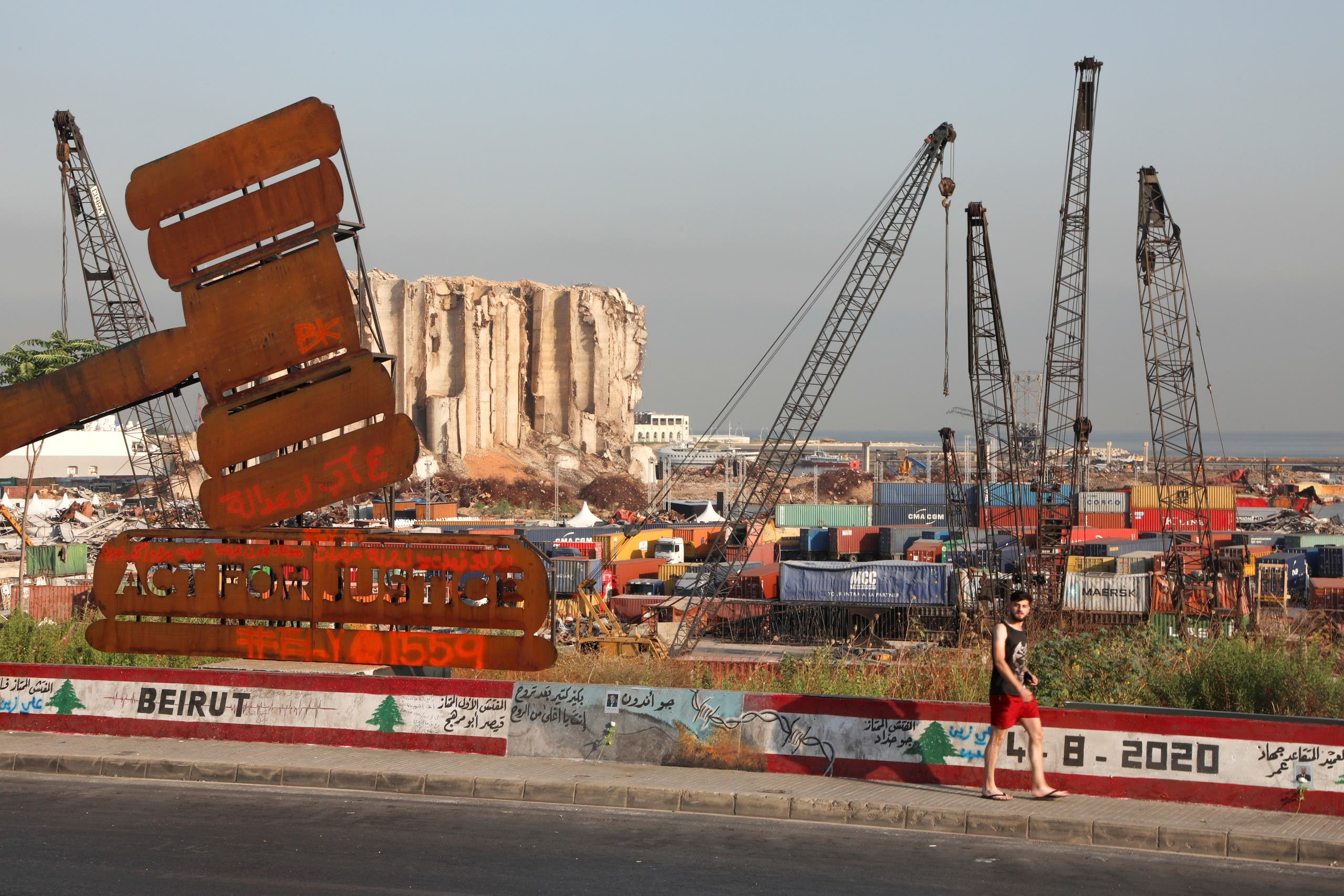 A justice symbol monument is seen near the grain silo damaged during last year's Beirut port blast, Aug. 4, 2021. (Reuters)