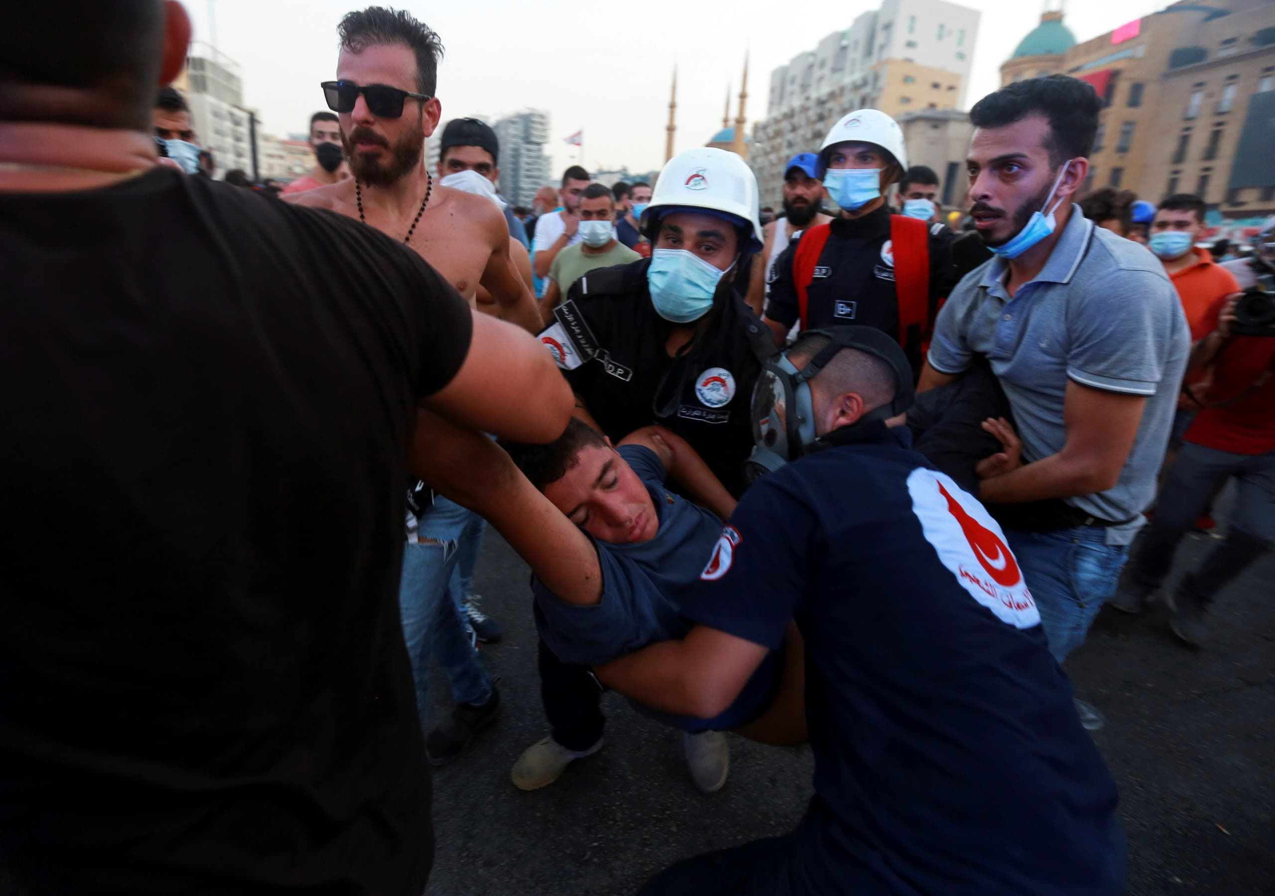 Medics evacuate a demonstrator affected by tear gas during a protest near parliament, as Lebanon marks the one-year anniversary of the explosion in Beirut, Lebanon August 4, 2021. (Reuters)