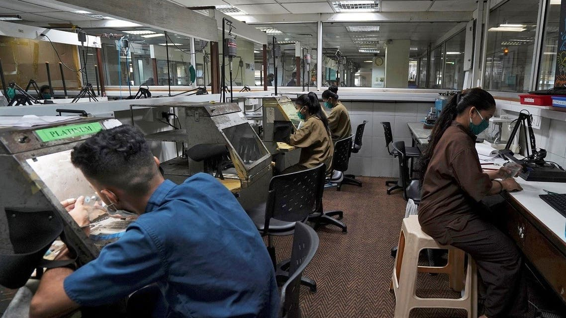 Employees work at a diamond jewellery manufacturing factory in Mumbai, India. (Reuters)