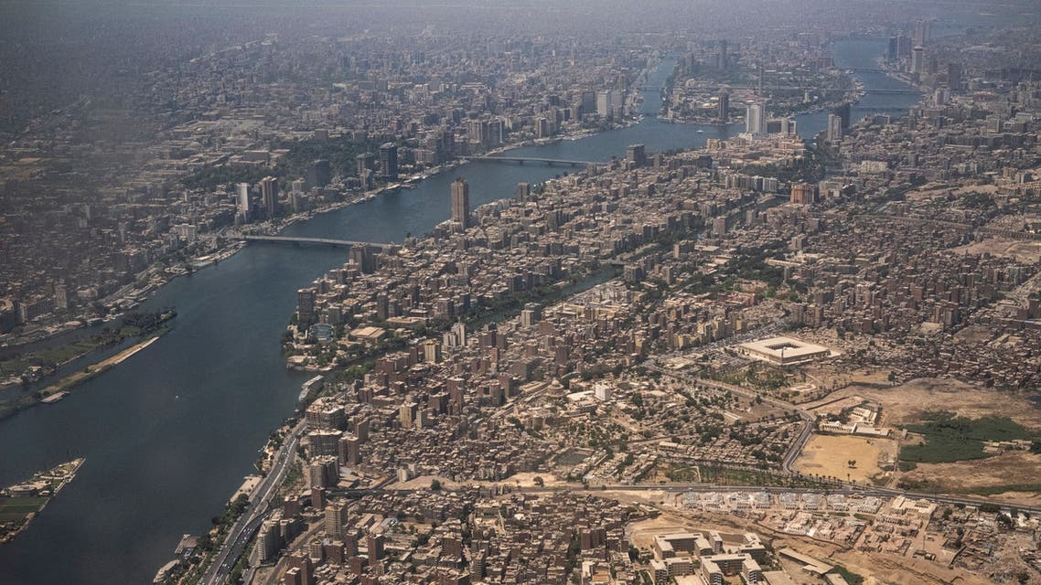 This picture taken on May 14, 2021 shows an aerial view of Egypt's capital Cairo, showing the historic old Cairo district (C) and the Nile river islands of (C to top) Manial al-Roda and Zamalek.