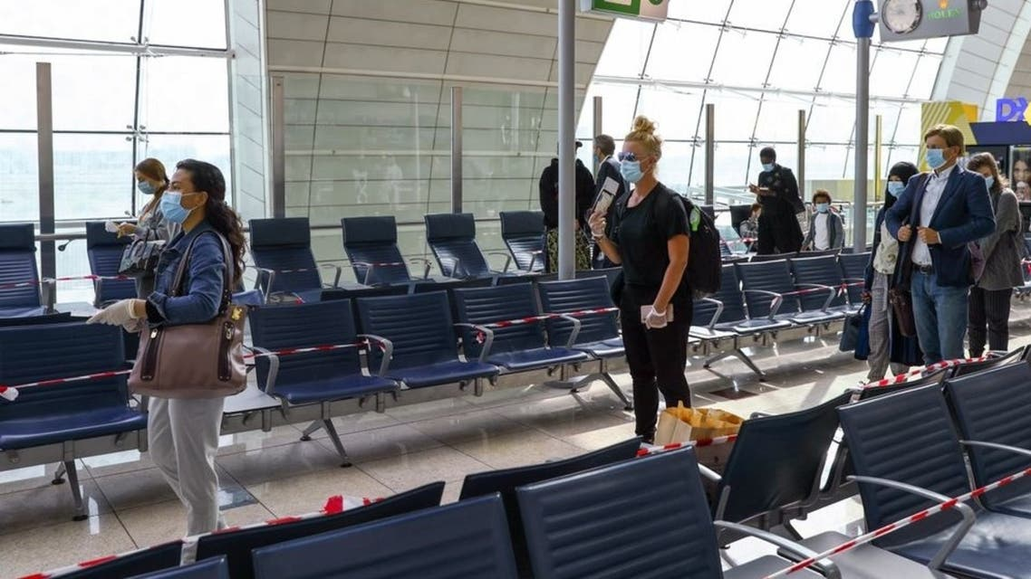 Passengers keep distance in a line at Dubai International Airport, as Emirates airline resumed limited outbound passenger flights amid the outbreak of the coronavirus in Dubai, UAE April 27, 2020. (Reuters)