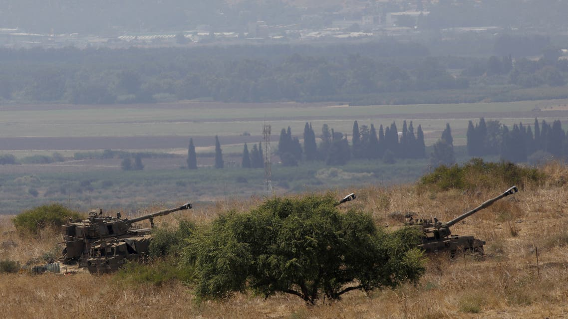 Israeli self-propelled artillery guns are positioned near the Lebanese border on the outskirts of the northern Israeli town of Kiryat Shemona on September 1, 2019. Tensions between the two rival countries have soared, after Lebanon accused Israel of targeting a stronghold of the Shiite Muslim Hezbollah movement with explosive-laden drones last week.