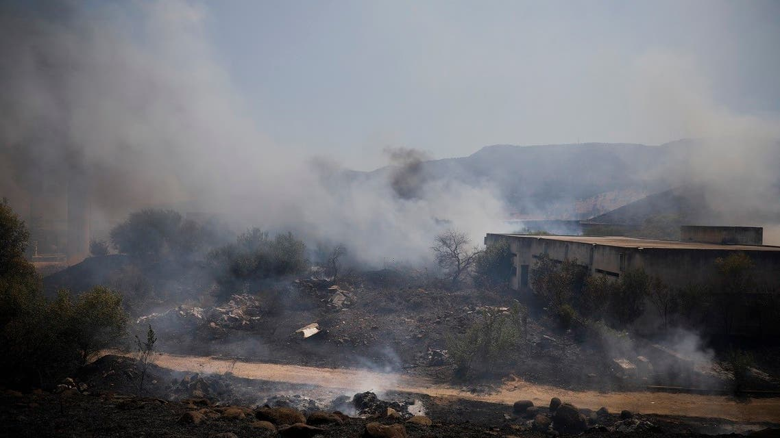 Fields burn following a hit by a rocket fired from Lebanon into Israeli territory, Aug. 4, 2021. (AP)