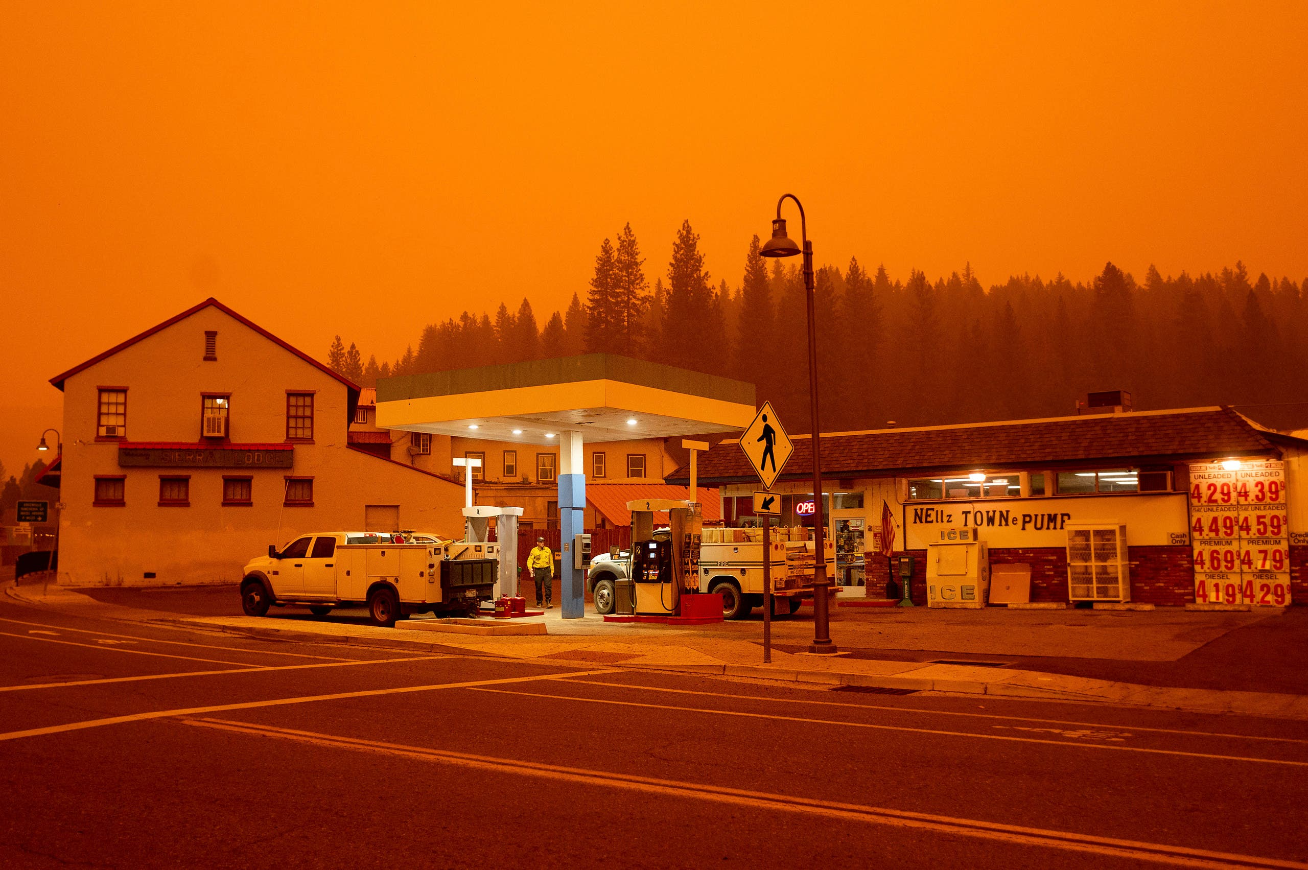 Firefighters gas up while battling the Dixie Fire in the Greenville community of Plumas County, California, on Friday, July 23, 2021. (AP)