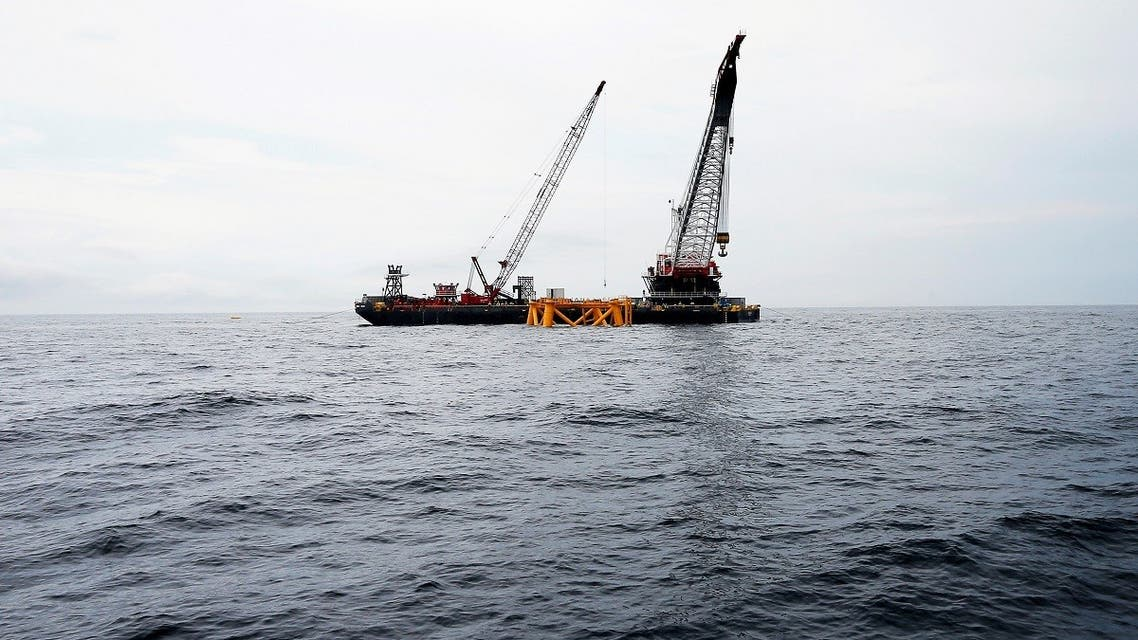 A crane hangs over the first jacket support structure installed to support a turbine for a wind farm in the waters of the Atlantic Ocean off Block Island, Rhode Island. (File photo: Reuters)